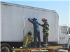 Firefighters cutting into trailer