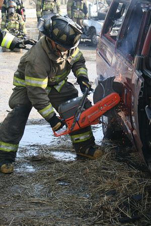 Firefighter using cutting tool