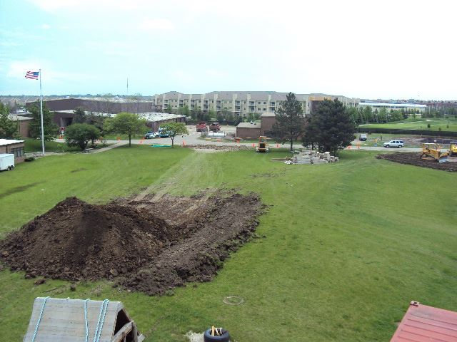 Pile of Dirt on Grass