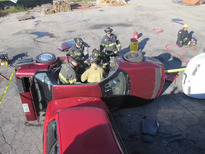 Firefighters training on vehicle extrication