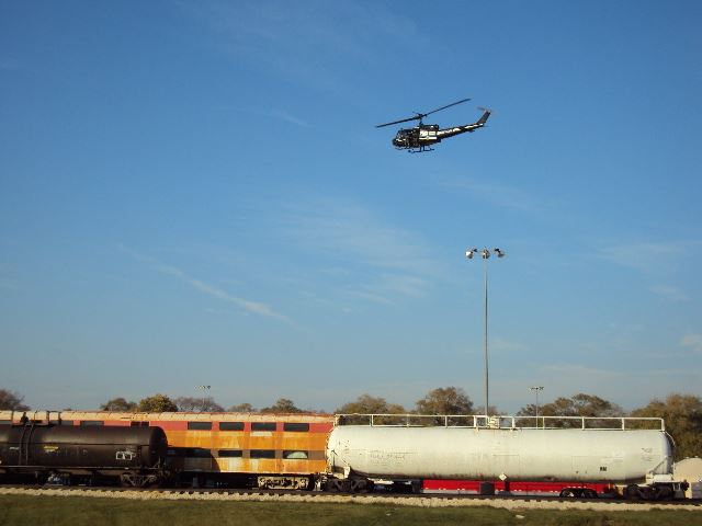 Helicopter flying over train cars