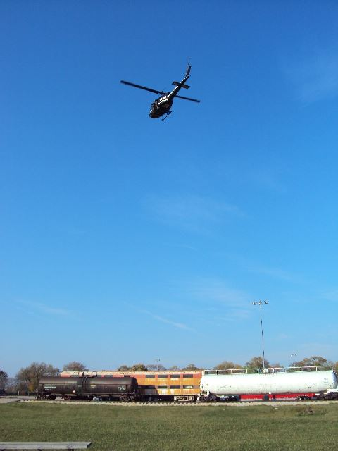Helicopter flying over train