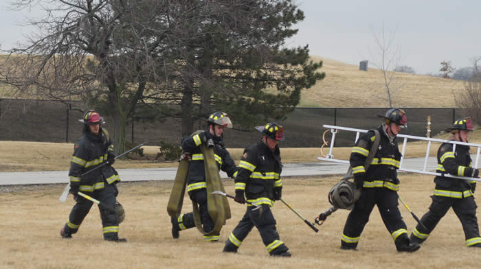 Firefighters walking with equipment