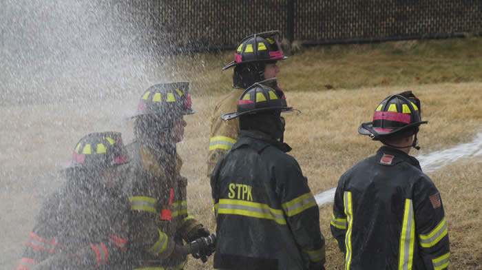 Firefighters training with hose