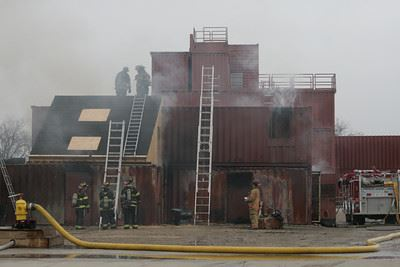 Firefighters training on burn house