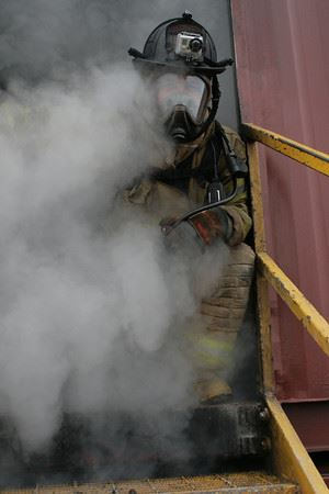 Firefighter surrounded by smoke