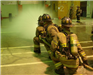 Firefighters spraying hose