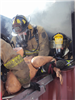 Firefighters carrying mannequin